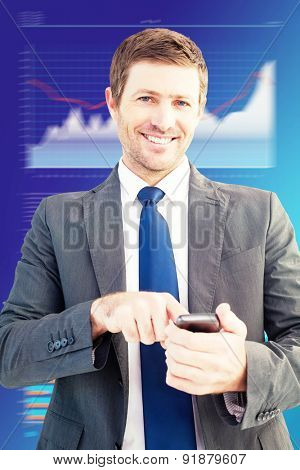 Businessman sending a text message against business interface with graphs and data