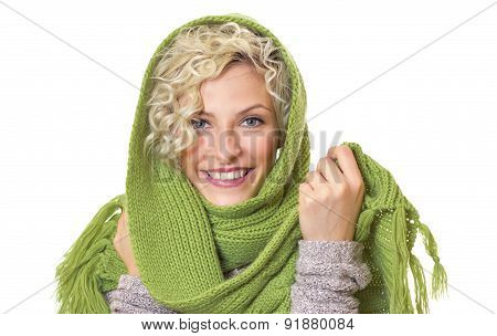 Portrait Of A Smiling Woman Wrapped With Wool Scarf And Cap, Isolated On White Background. Girl Wear