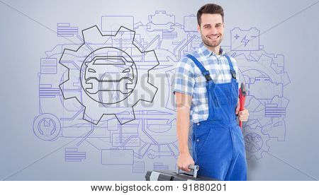 Smiling young male repairman carrying toolbox against grey vignette