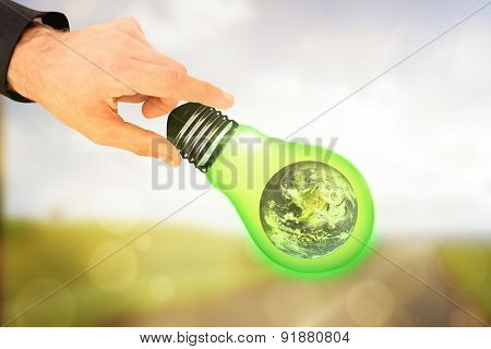 Businessman measuring something with these fingers against orange abstract light spot design