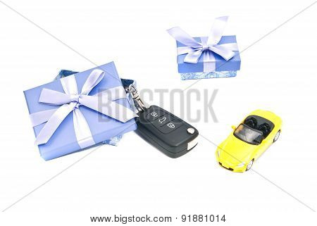 Two Gift Boxes, Yellow Car And Keys