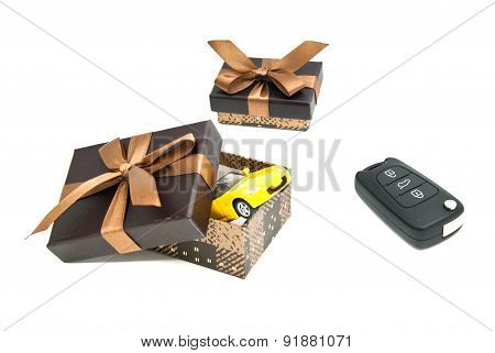 Car Keys, Yellow Car And Brown Gift Boxes