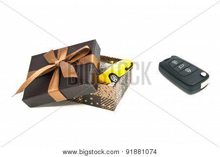Car Keys, Yellow Car And Gift Box