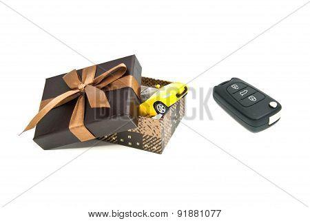 Car Keys, Yellow Car And Brown Gift Box