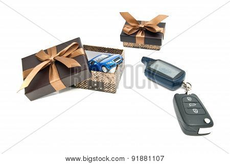 Blue Car, Keys And Brown Gift Boxes