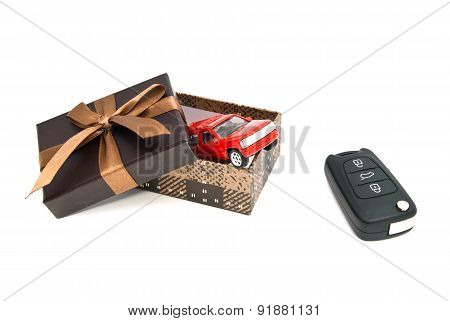 Red Car, Keys And Brown Gift Box