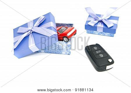 Red Car, Keys And Two Blue Gift Boxes