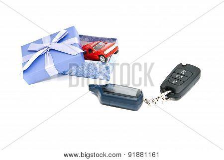 Car Keys, Red Car And Blue Gift Box