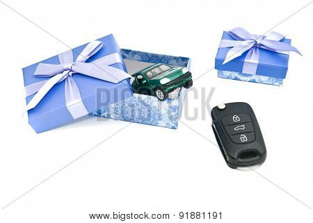 Keys, Green Car And Blue Gift Boxes