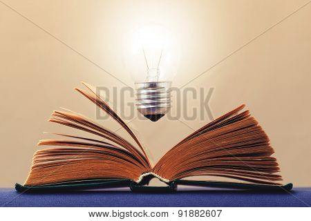 Light On The Book Symbolizes The Idea