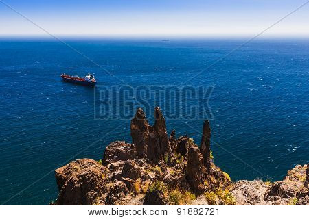 Container Cargo Ship And Vessel On Horizon