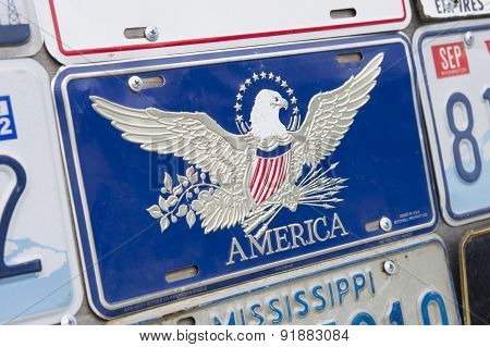 Stand with American license plate