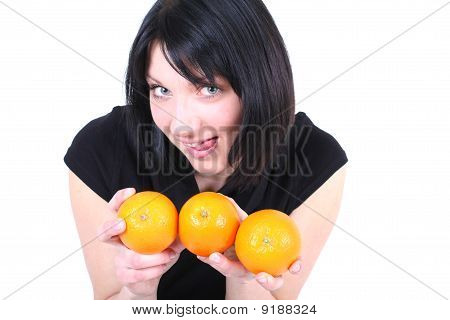 Young Beautiful Ridiculous Woman With Oranges