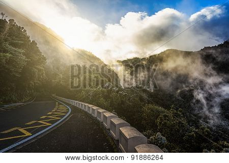 Road In Mountains At Sunset