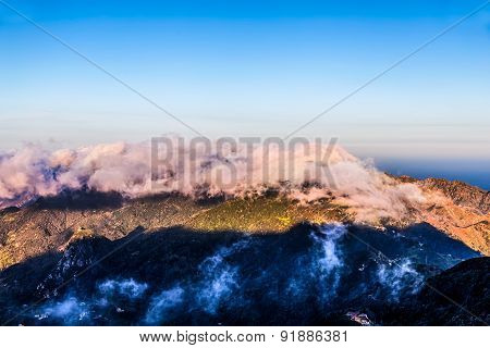 Mountains With Clouds On Blue Sky