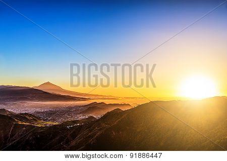 Sun Over Mountains On Blue Sky