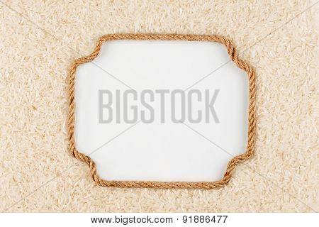 Figured Frame Made Of Rope With Rice Grains  Lying On A White Background