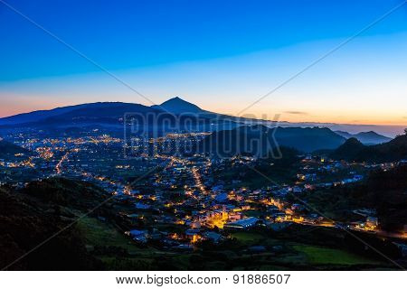 City Or Town With Illumination After Sunset