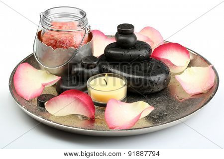 Spa stones, sea salt and rose petals on tray, isolated on white