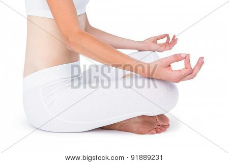 Fit woman meditating on white background