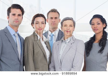 Business people looking at camera in the office
