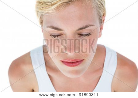 Fit woman meditating eyes closed on white background