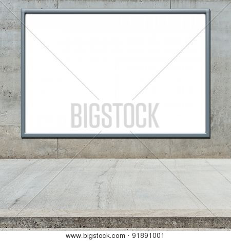 Blank advertising billboard on a concrete wall.