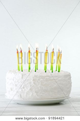 Birthday cake with candles on light background