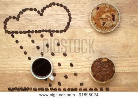 Top view coffee,muffins and figure cloud from coffee beans