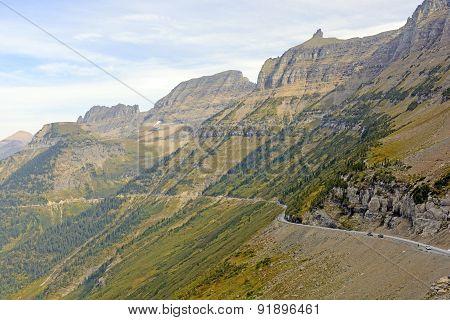 Narrow Winding Road Going Up A Mountain Ridge