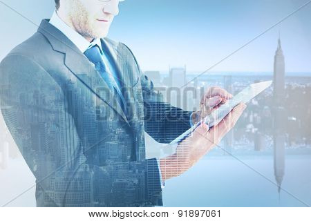 Mid section of a businessman using digital tablet against new york