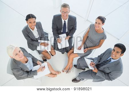 Business people in board room meeting at office