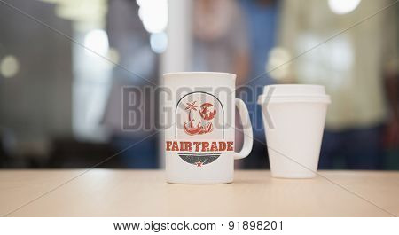 Fair Trade graphic against close up of mug on the desk