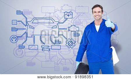 Mechanic holding tire while showing thumbs up against grey vignette