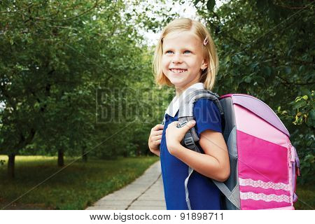Schoolgirl Goes To School With School Bag.