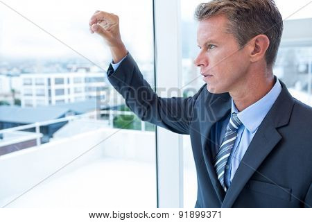 Businessman looking out the window in his office