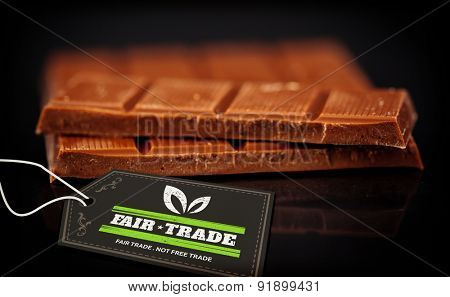 fair trade stamp against blurred bar of chocolate