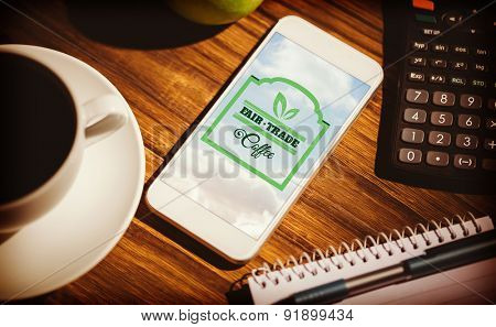 Fair Trade graphic against smartphone on table