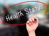 stock photo of status  - Man hand writing Health Status on visual screen - JPG