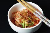 stock photo of kimchi  - Bowl of Kimchi on a Black Background - JPG