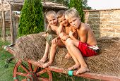 picture of hay bale  - boys sitting on a hay bale - JPG