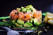 image of tartar  - Tasty salmon and avocado tartar dark background - JPG