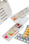 image of dispenser  - tablet dispenser and tablets symbolfoto for therapy - JPG