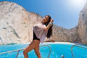image of shipwreck  - Woman sailing at shipwreck navagio beach in Zakynthos Greece - JPG
