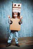 picture of dragon  - Little dreamer boy playing with a cardboard dragon - JPG