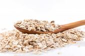 image of whole-grain  - Whole grain rolled oats flakes with wooden spoon - JPG
