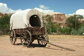 stock photo of covered wagon  - a covered wagon with white top in bluff utah - JPG