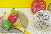 picture of decoupage  - Colorful jelly rolls on a handmade decoupage wooden spoon - JPG
