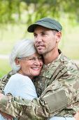 picture of reunited  - Soldier reunited with his mother on a sunny day - JPG