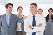 foto of congratulation  - Business people congratulating their colleague in the office - JPG